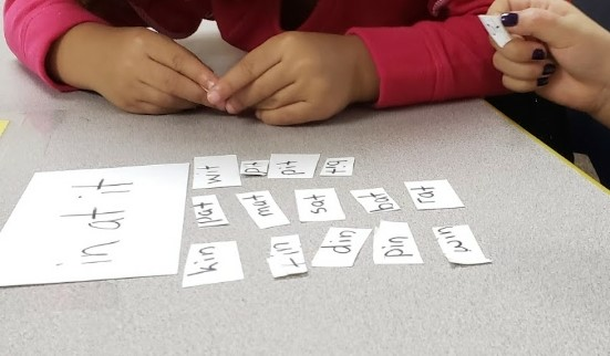 Pre-K students playing word family game