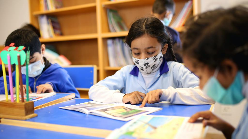 """Children wearing face mask in school. Picture found on unabashedkids.com """"back to school (covid safe)"""" blog"""